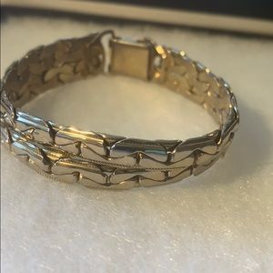 Silver in color estate bracelet with a clasp
